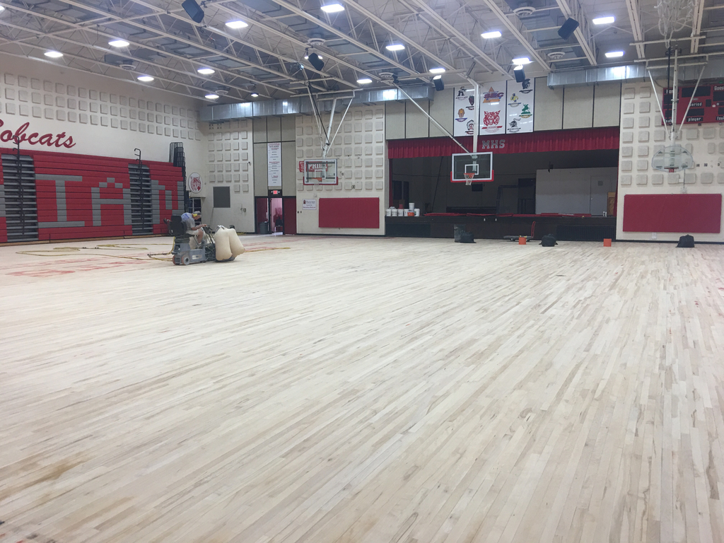 New floor being completed in the gym!